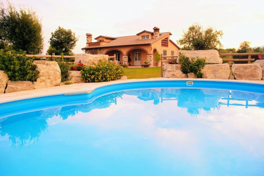 The swimming pool at or near Tuscan Villa Exclusive Use Of Private Pool Ac Wifi