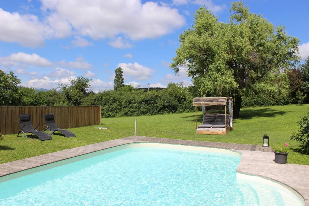The swimming pool at or near La Maison de Boyeux