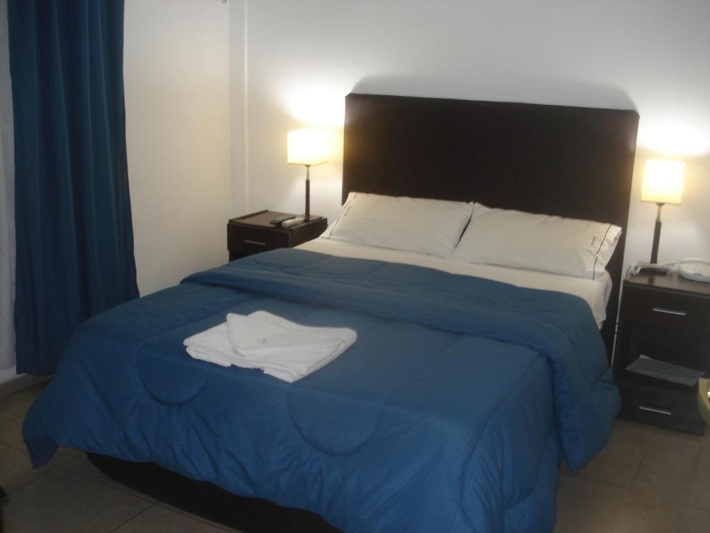 A bed or beds in a room at Morada Suites