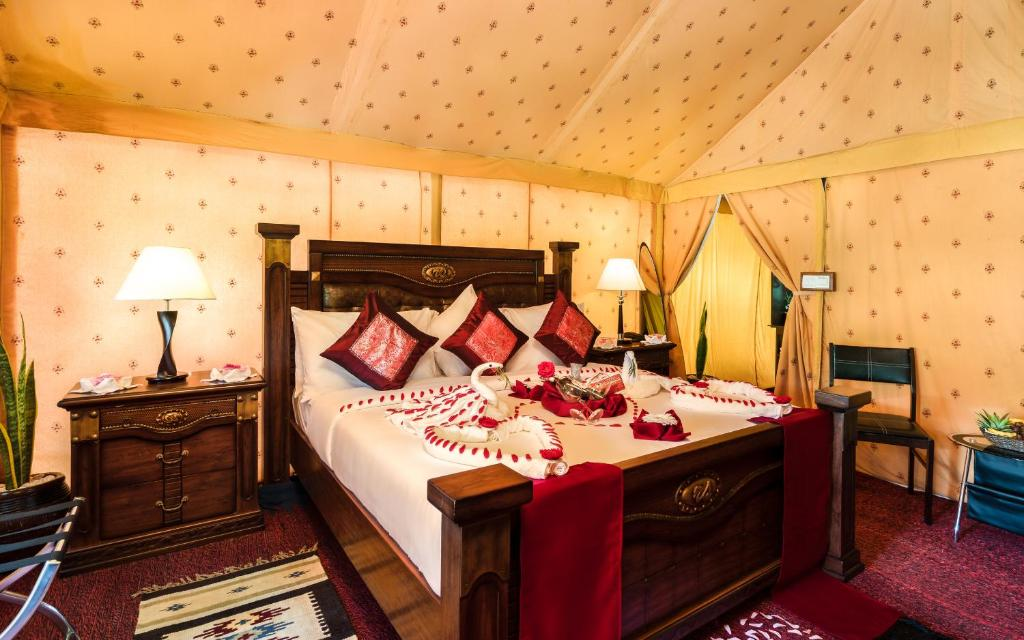 A bed or beds in a room at Fun Retreat Resort