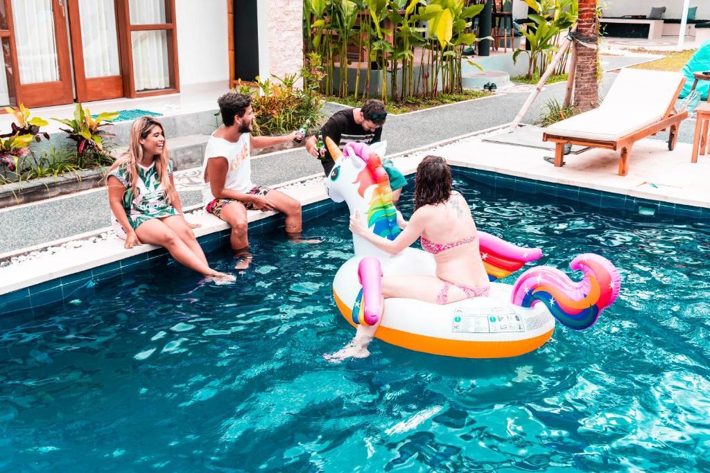 The swimming pool at or near Bali Beats Guesthouse Uluwatu