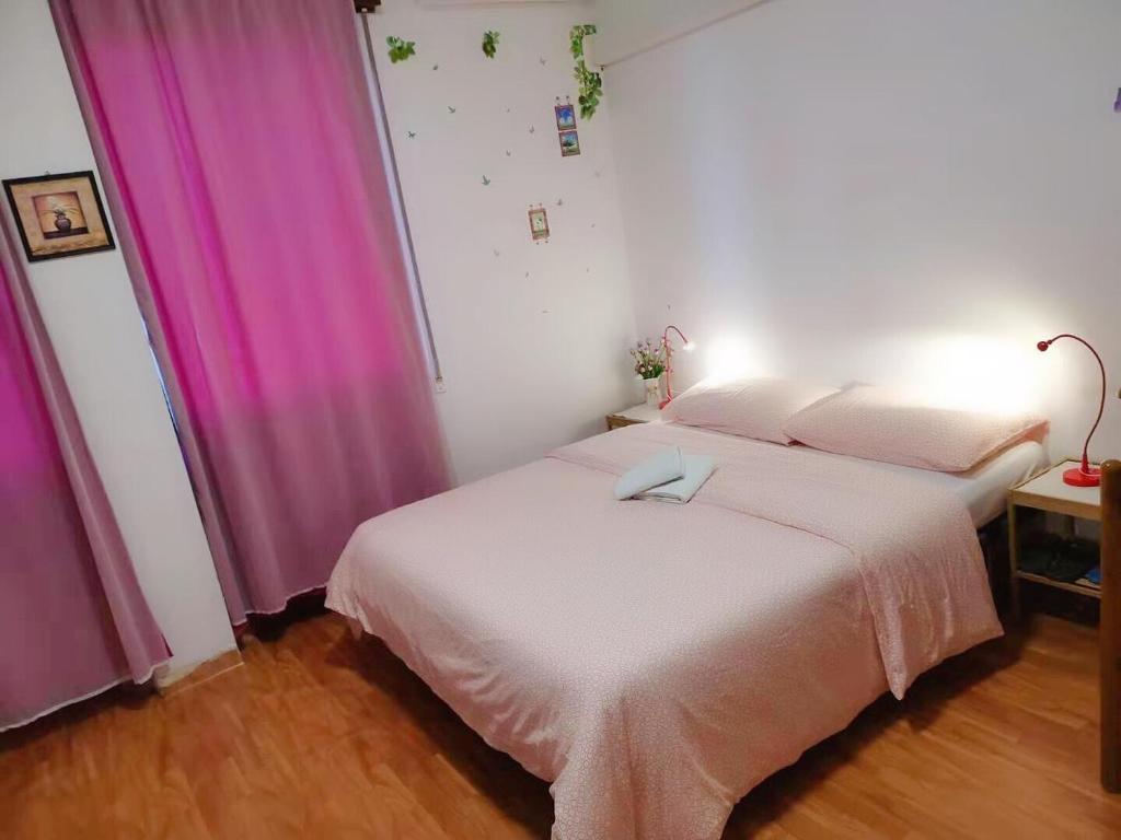 Een bed of bedden in een kamer bij Casa di Venice Yuanlai