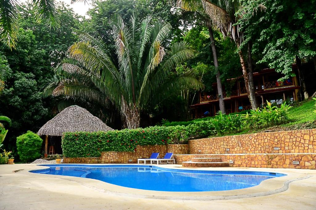 The swimming pool at or near Esencia Hotel and Villas