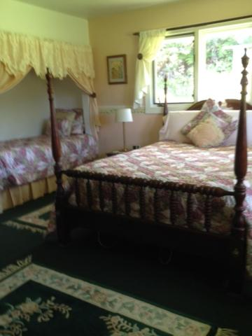 A bed or beds in a room at At the End of the Road Bed and Breakfast