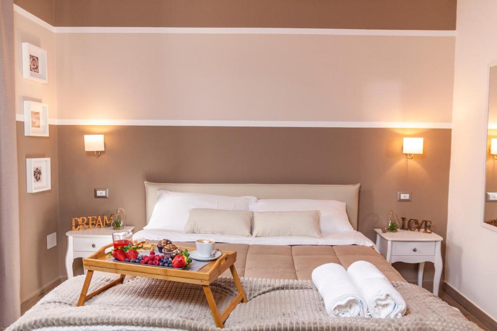 A bed or beds in a room at Al Vicolo tre