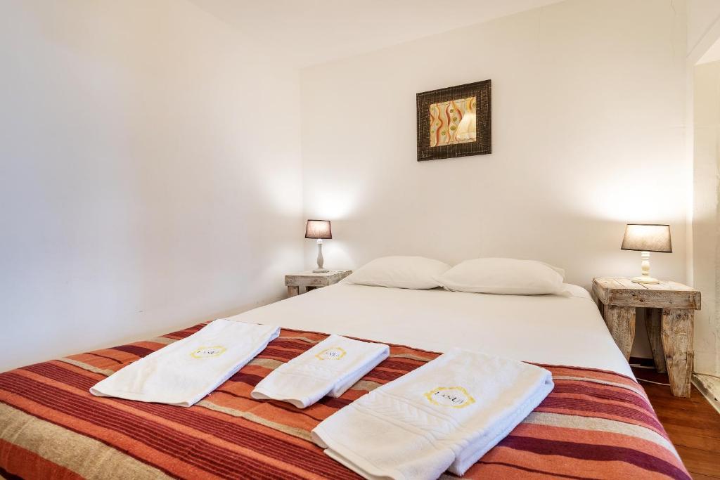 8b5c009f41b1 Uma cama ou camas num quarto em Lanui Belem Apartment
