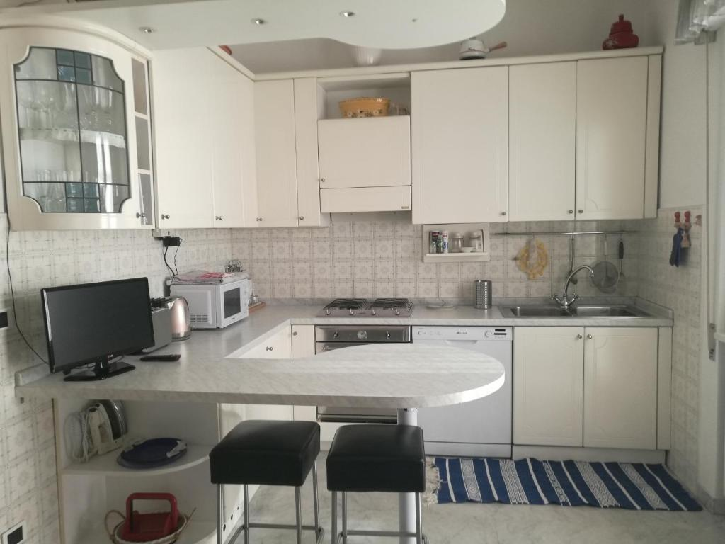 A kitchen or kitchenette at Casa Santa Gemma