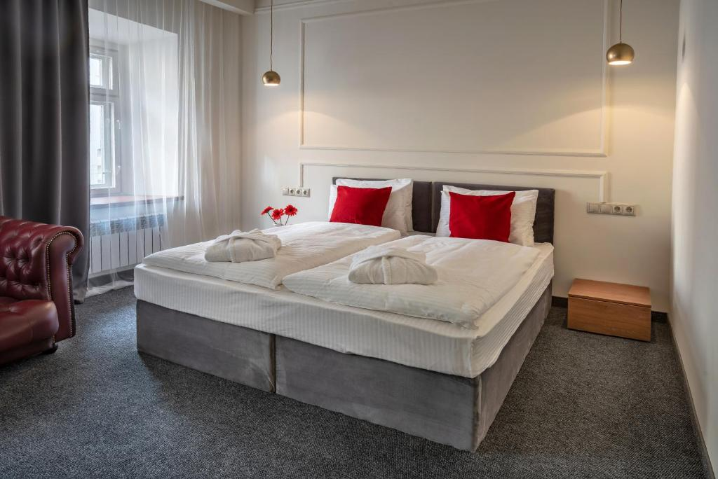 A bed or beds in a room at Tverskaya Residence