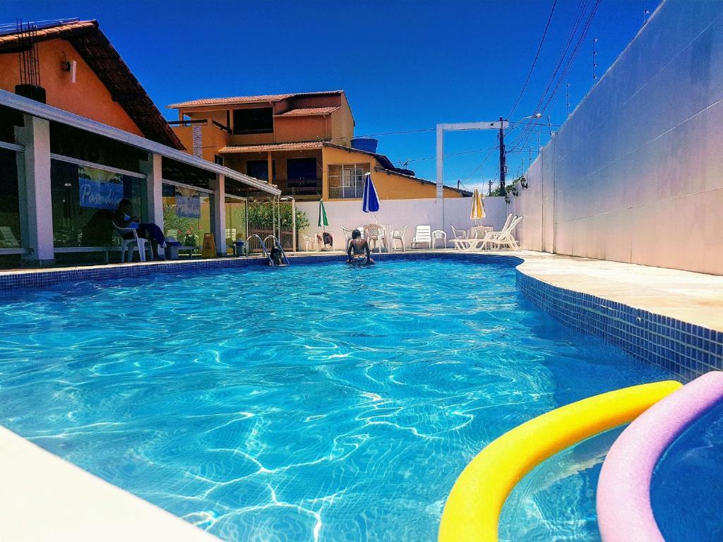 The swimming pool at or near Pousada Paradise
