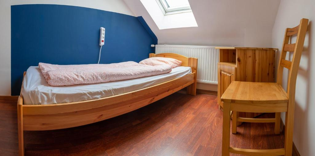 A bed or beds in a room at Lima Hostel Győr