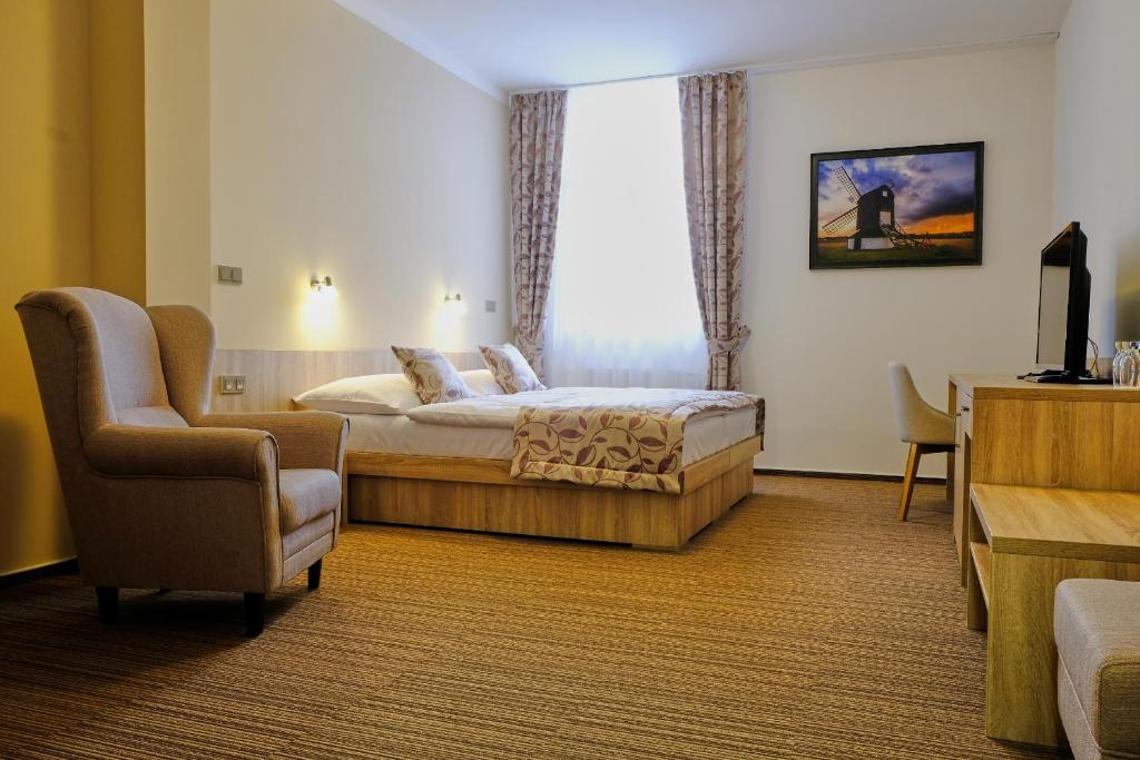 A bed or beds in a room at Hotel GTC 3* superior