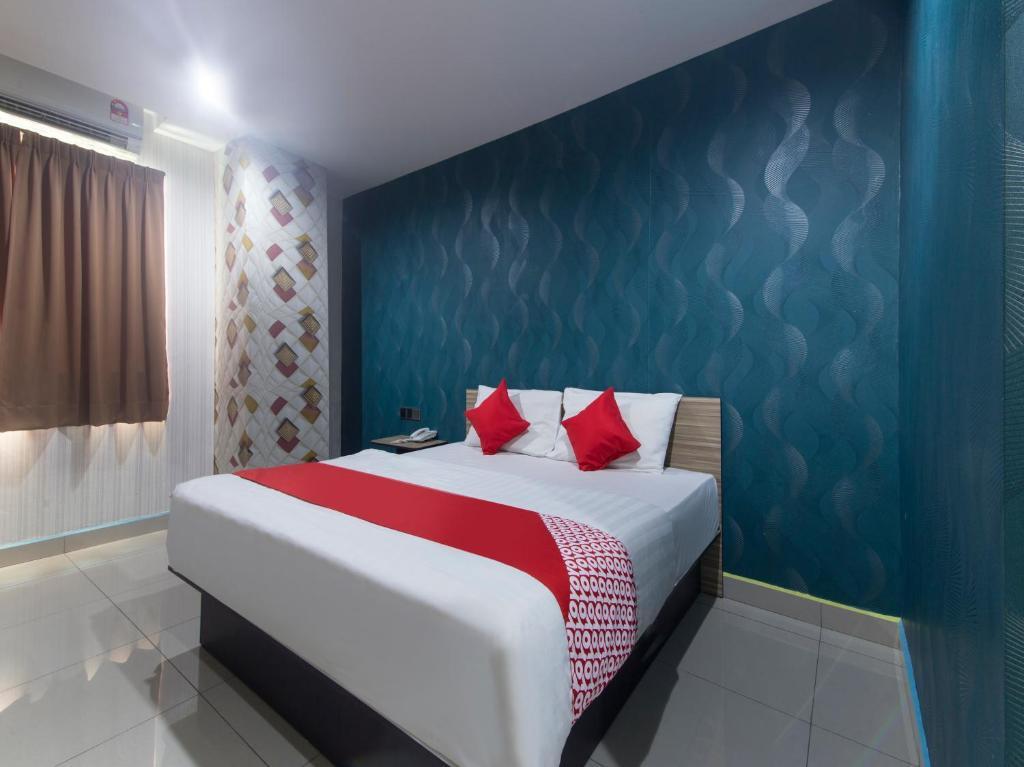 Katil atau katil-katil dalam bilik di OYO 804 Hotel Pinji