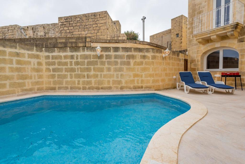 The swimming pool at or near Entire Villa - Gemini Farmhouse, Nadur Gozo