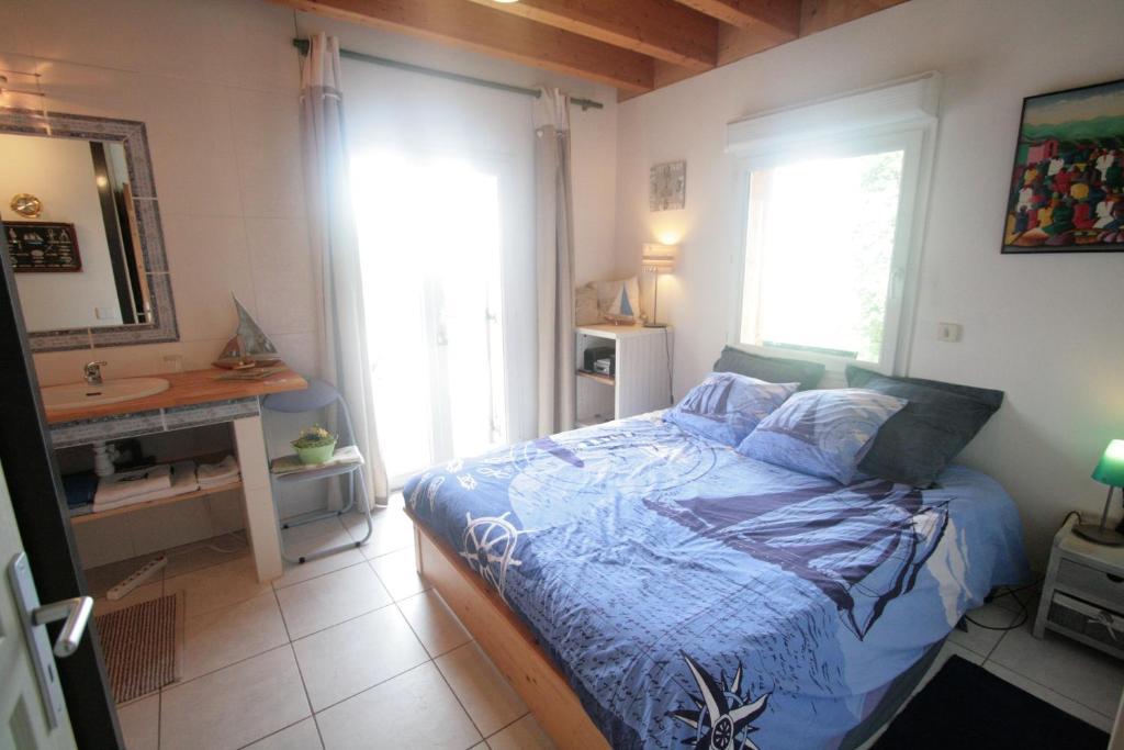 Un ou plusieurs lits dans un hébergement de l'établissement Chambre d'Hôtes Lenoble