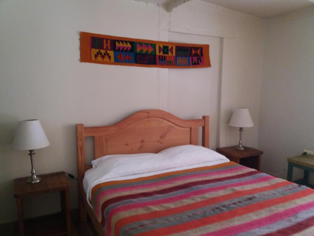 A bed or beds in a room at Hostal Nuevo Amanecer