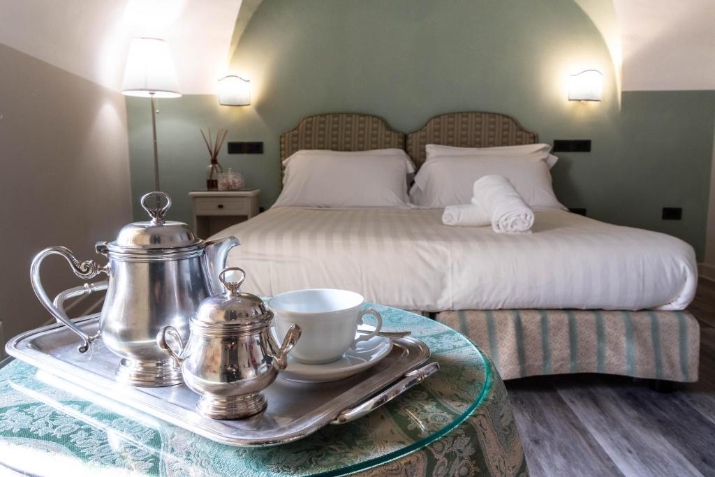 Letto o letti in una camera di Hotel Fontebella