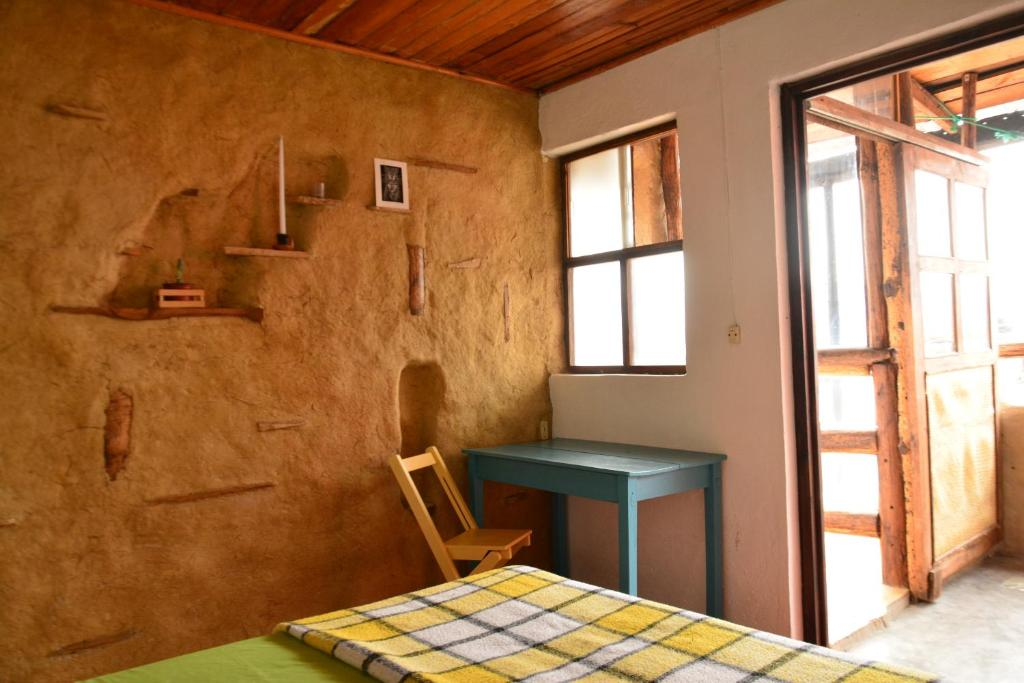 A bed or beds in a room at Casa Hamsa