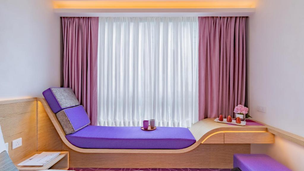 A seating area at Hotel Purple Hong Kong
