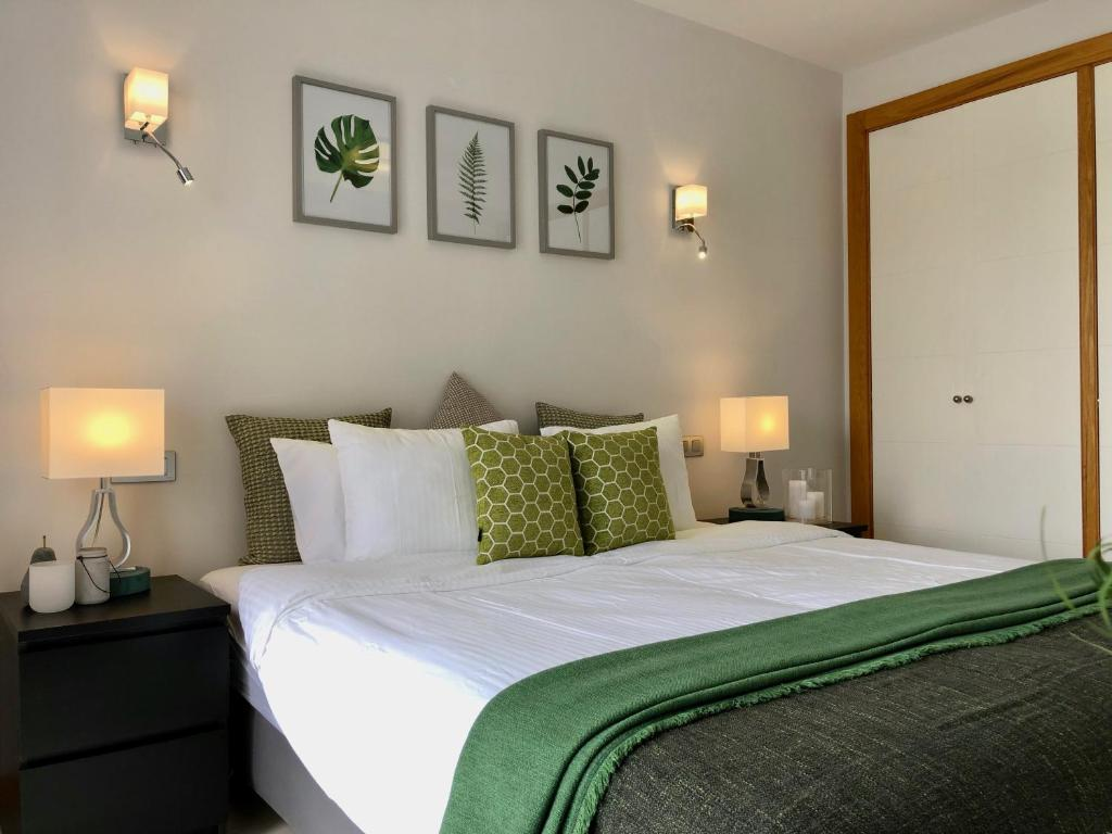 A bed or beds in a room at Vista Golf 15