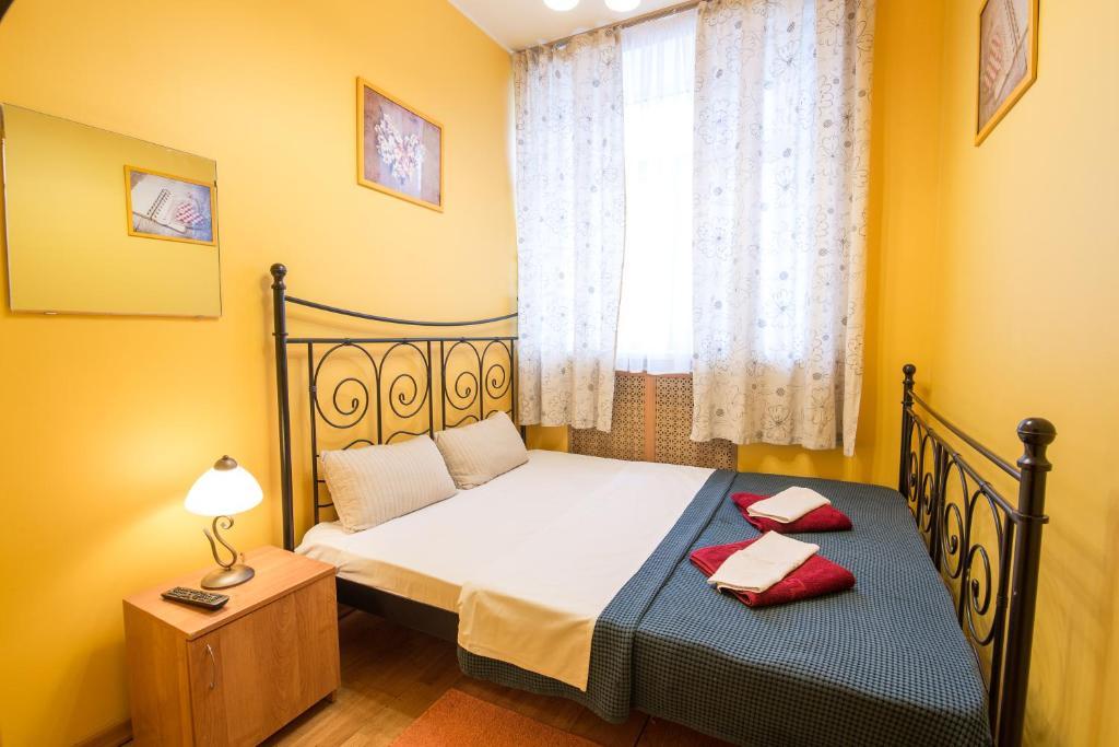 Кровать или кровати в номере Хостел Артист на Бауманской