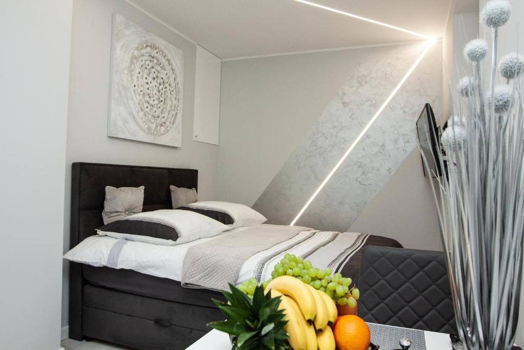 Ein Bett oder Betten in einem Zimmer der Unterkunft Novel