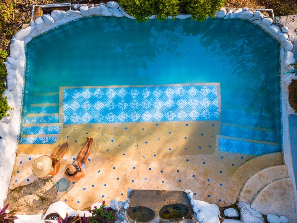 The swimming pool at or near Casa Relax Minca Guest House