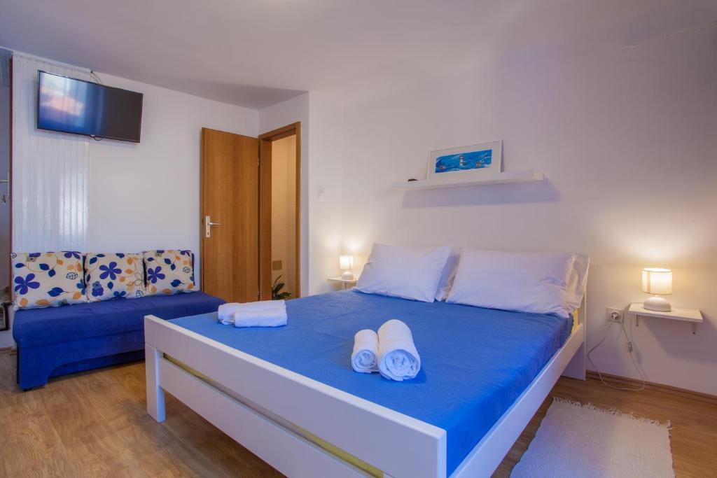 Postelja oz. postelje v sobi nastanitve Room M
