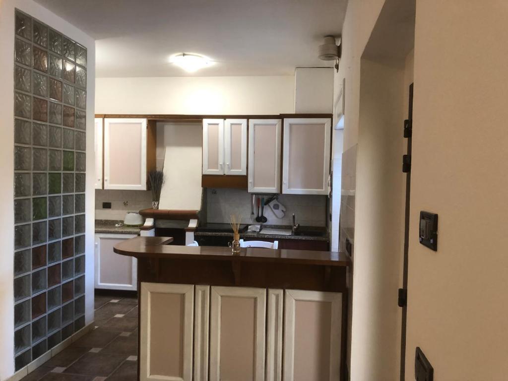 A kitchen or kitchenette at Appartamento Lidia