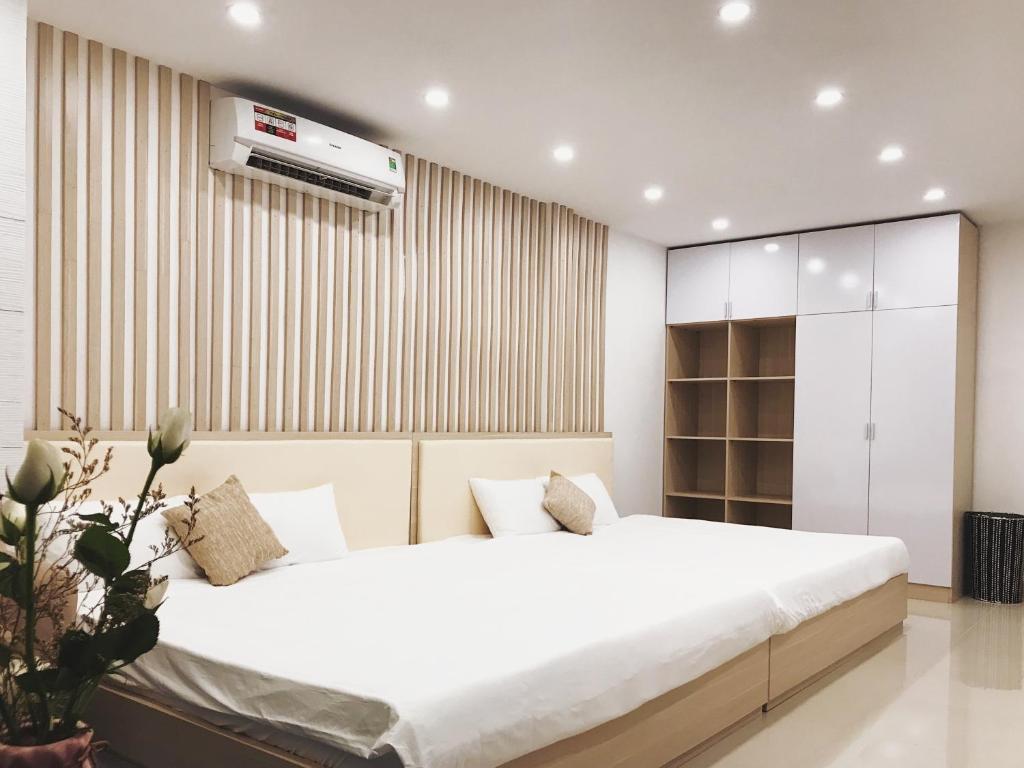 L'amai House tesisinde bir odada yatak veya yataklar