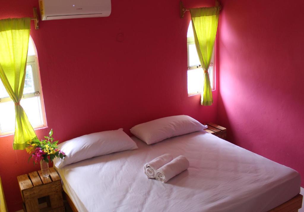 Cama o camas de una habitación en El Faro Hostel