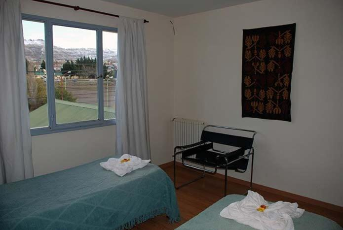 A bed or beds in a room at Departamentos Cotecal