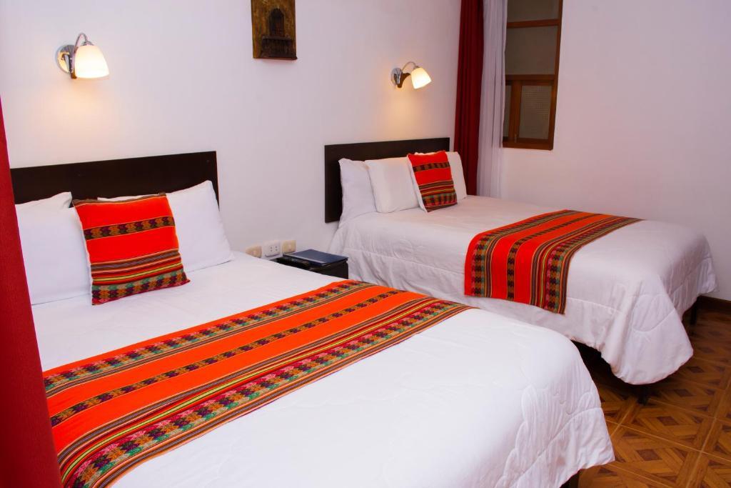 Een bed of bedden in een kamer bij La Casa de Los Balcones