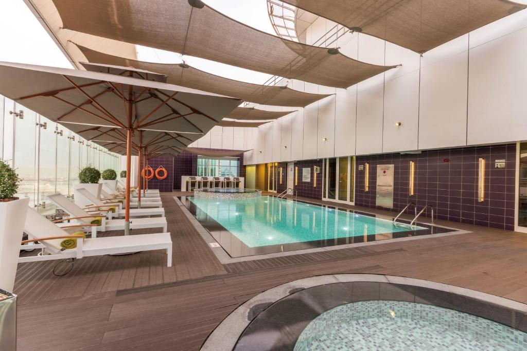 The swimming pool at or near The Act Hotel Sharjah