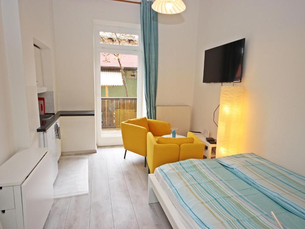 Télévision ou salle de divertissement dans l'établissement Apartment Glasmalerei.3