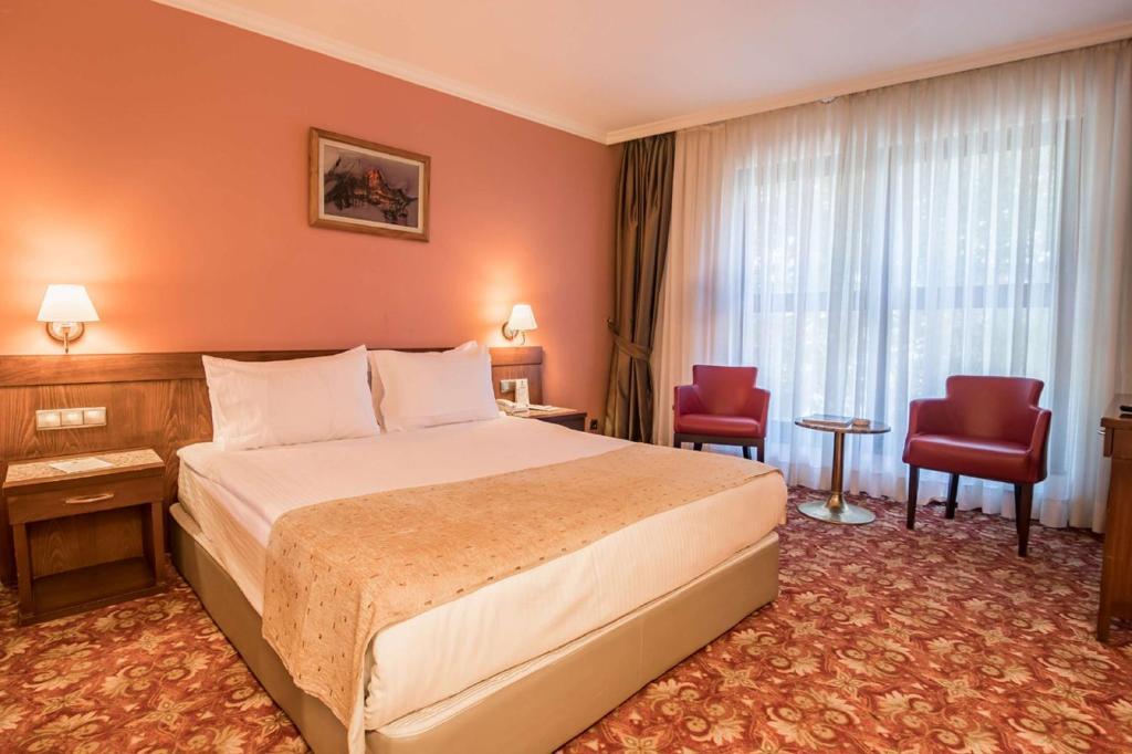 Кровать или кровати в номере Best Western Hotel Ikibin-2000