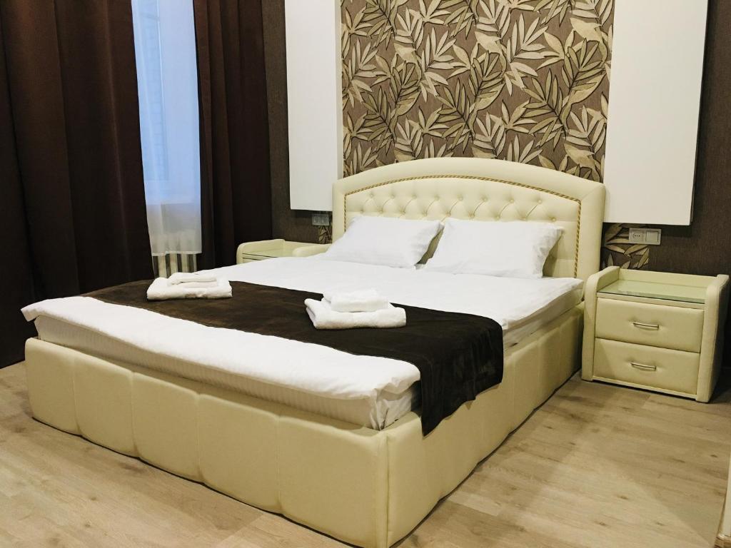 Кровать или кровати в номере Elegance Moskovsky