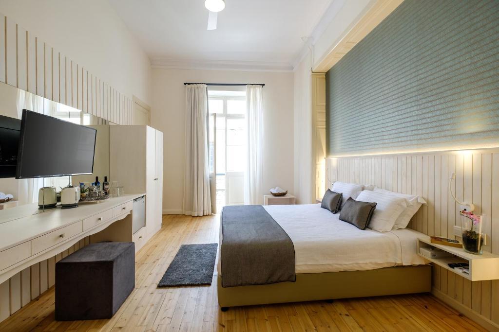Letto o letti in una camera di La Maltese Mansion