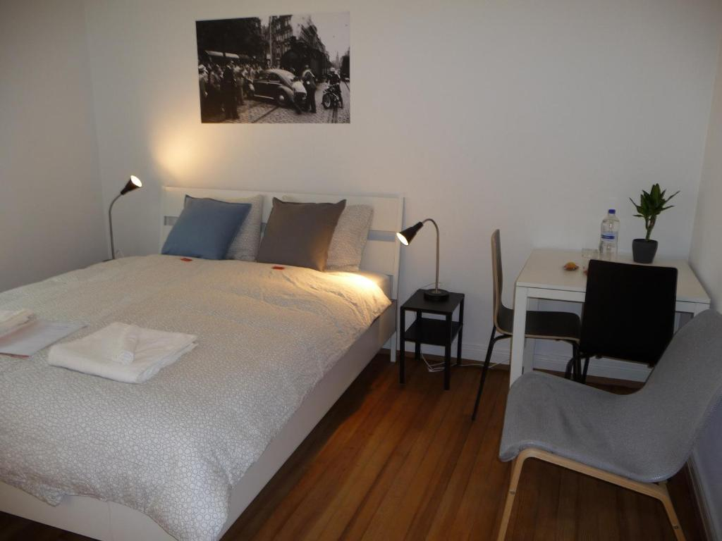 A bed or beds in a room at rooms lux city