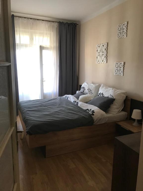 Posteľ alebo postele v izbe v ubytovaní Apartman Jana