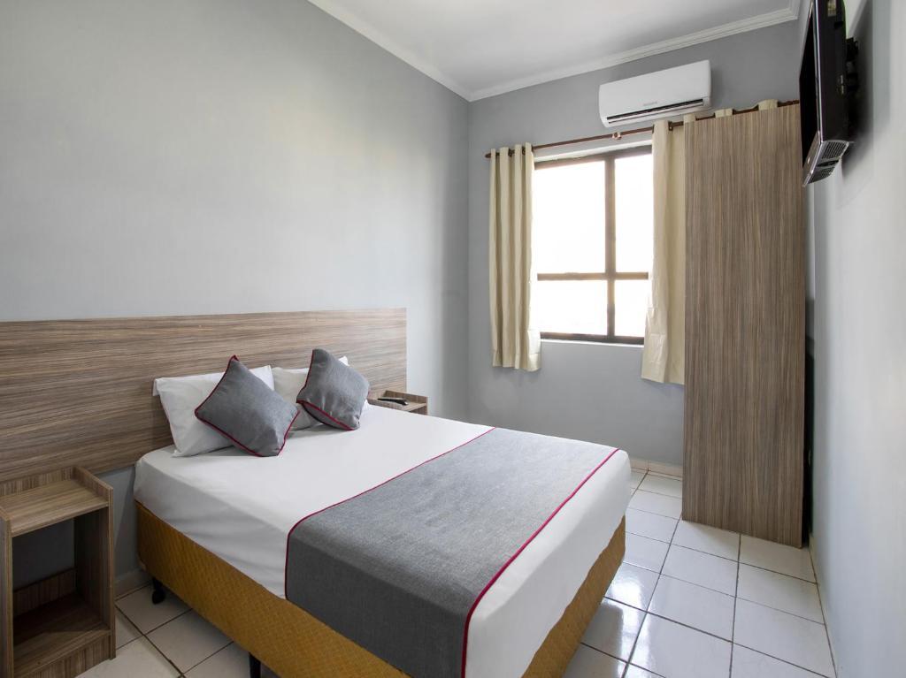 Uma cama ou camas num quarto em OYO Hotel Centro Brás