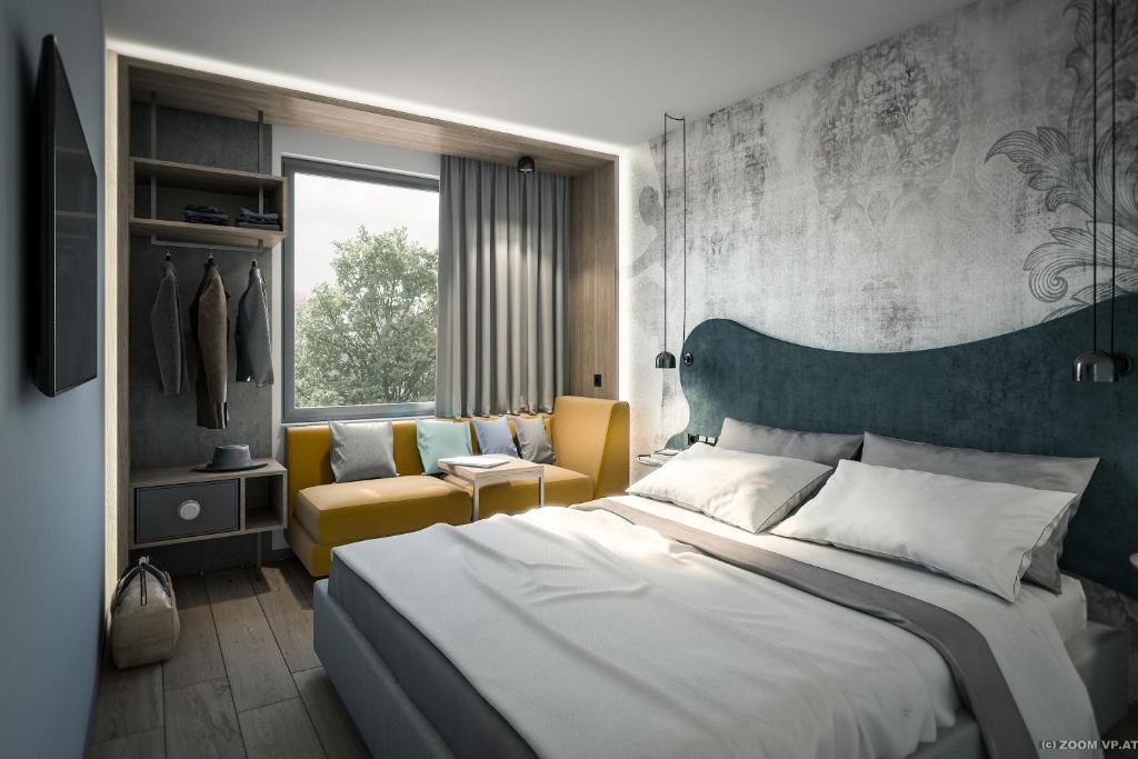 A bed or beds in a room at Hotel Rainers21