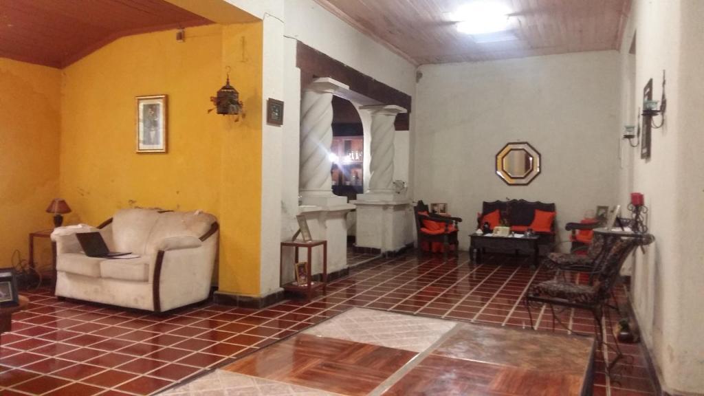 A seating area at Hostal mi otra casa en santa ana
