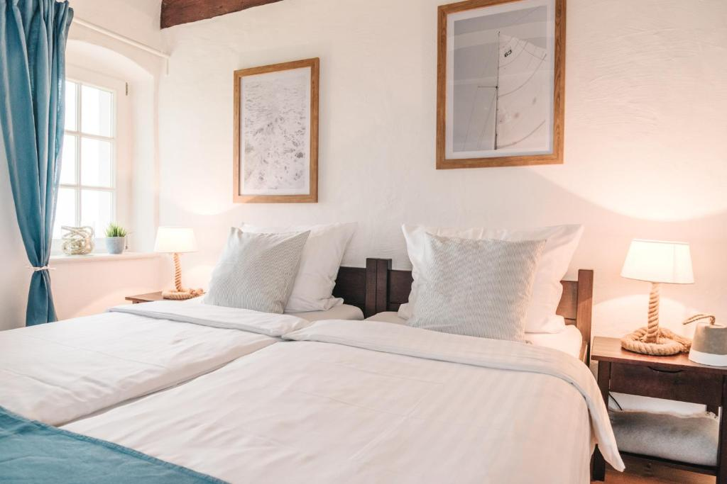 Ein Bett oder Betten in einem Zimmer der Unterkunft Inselhus Wilhelmstein