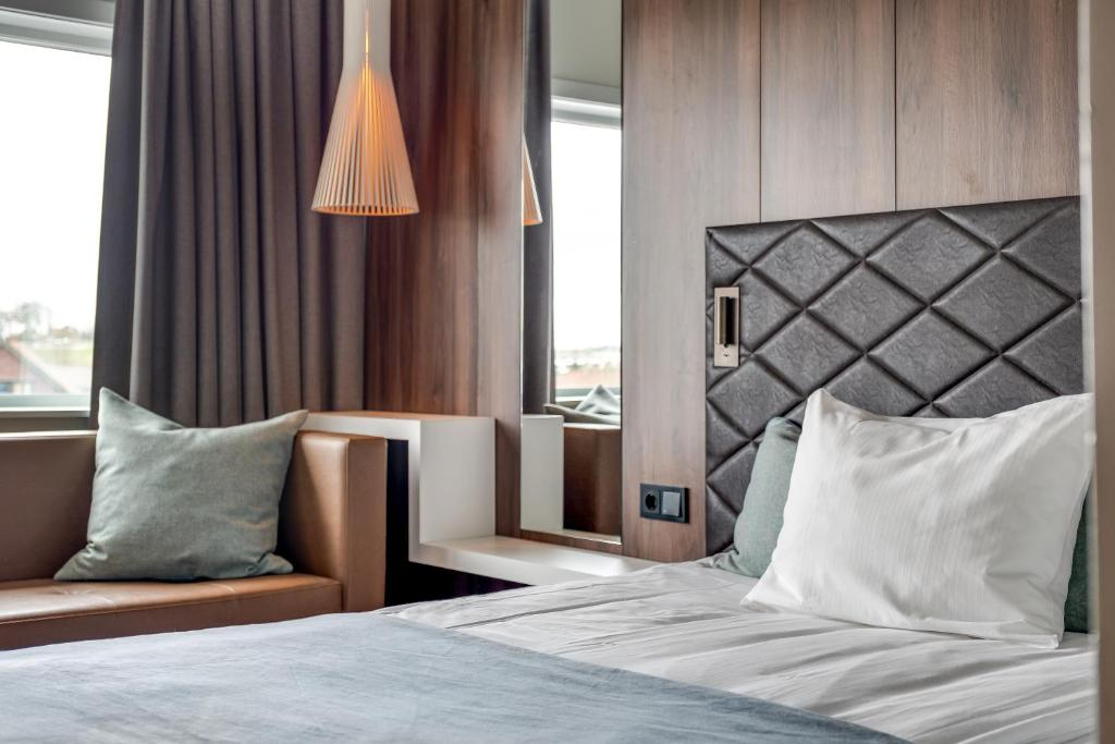 A bed or beds in a room at Quality Airport Hotel Stavanger