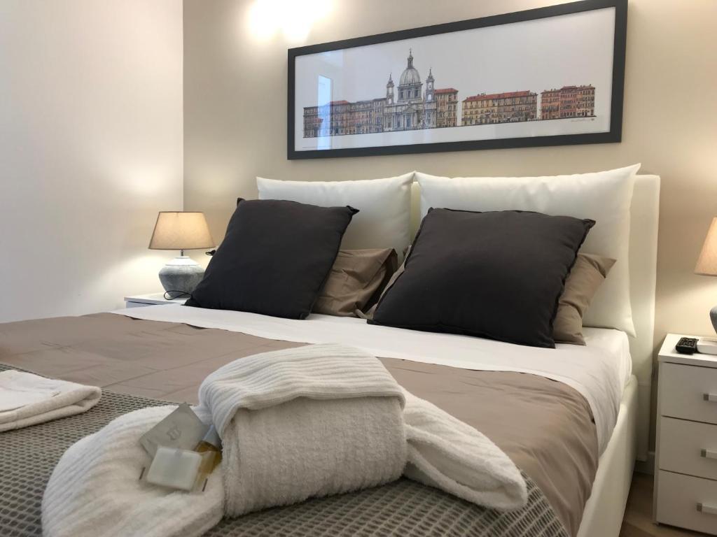Cama o camas de una habitación en BREAK - Via Veneto Charming Suite