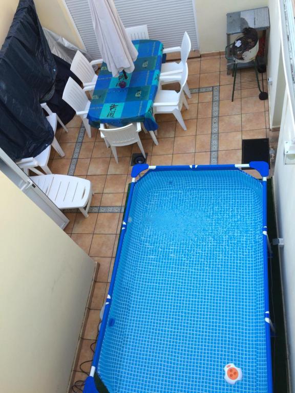 The swimming pool at or near CASITA CHALET CON TODAS LAS COMODIDADES Y LUJOS