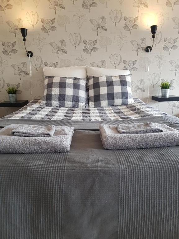 Säng eller sängar i ett rum på Bröttorp