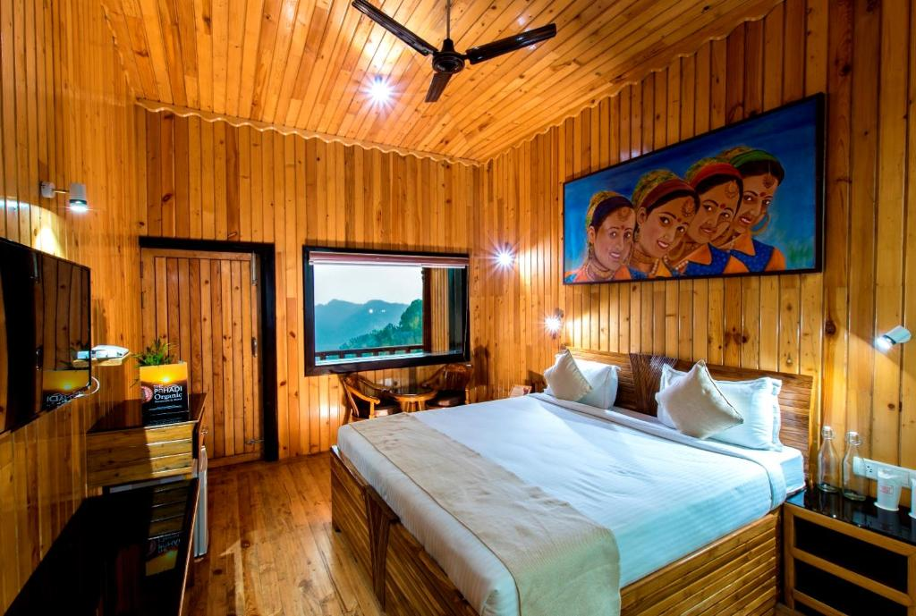 A bed or beds in a room at The Pahadi Organic