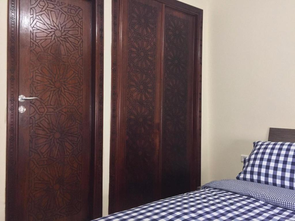A bed or beds in a room at Oued Laou - Ground Floor