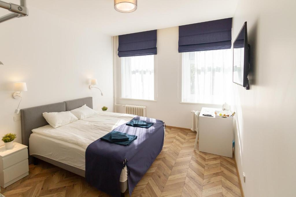 A bed or beds in a room at Hot Spot Vilnius Apartments